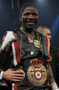 Hassan N'Dam of France celebrates after defeating Georgia's Avtandil Khurtsidze in their WBA middleweight boxing world championship fight at Palais des Sports in Paris, Saturday Oct. 30, 2010. The 26-year-old N'Dam, a Cameroon-born fighter recently granted French citizenship, received winning scores of 117-111, 115-114 and 115-114 from the judges to improve to 25-0, and became the interim WBA champion. Kazakhstan's Gennady Golovkin is the recognized titleholder.(AP Photo/ Francois Mori)